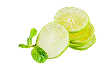 Fresh lime slice with mint leaves isolated on white background, top view copy space. Summer refreshment cocktail ingredient concept.