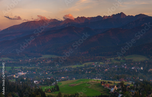 Tatra Mountains and resort Zakopane in the rays of the setting sun