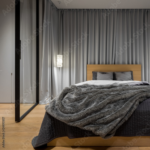 Stylish bedroom with double bed - 244951817