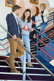 young people going down cinema stairs carrying popcorn - 244970499