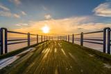 Fototapeta Fototapety pomosty - Wschód słońca na pomoście © Maciej