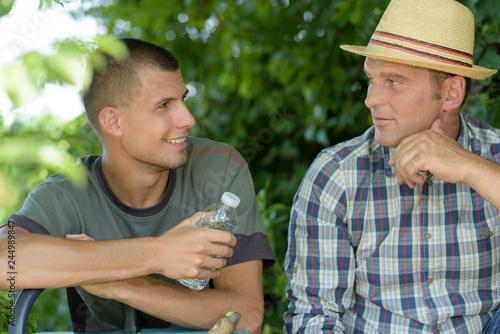 Leinwandbild Motiv two agricultural workers taking a break