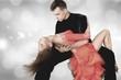 Leinwanddruck Bild - Man and a woman dancing Salsa on background