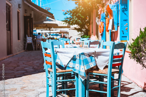 Outside traditional blue and white restaurant, greek tavern concept vacation in Greece