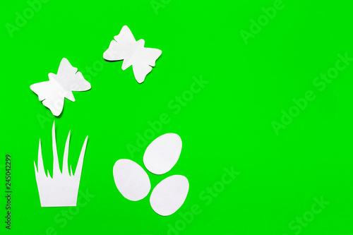 Three white easter eggs, grass and butterflies cut of paper on green background, easter and spring concept - 245042299