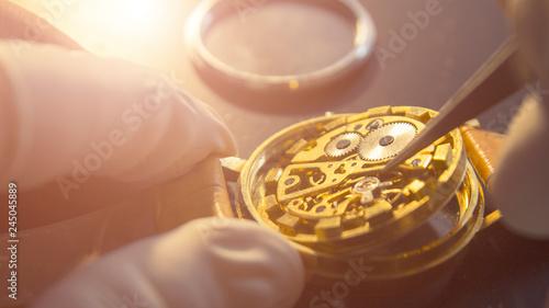 Leinwandbild Motiv Process of repair of the mechanical watches