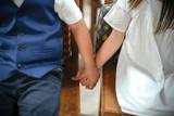 Little boy and little girl holding hands - 245067076