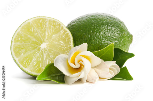 green lime with half of  juicy lime and beautifull flower isolated on white background - 245096479
