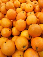 Ripe tangerines in a store window