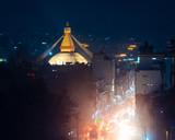 Boudhanath stupa and Boudha Road at night in Nepal.  - 245150233