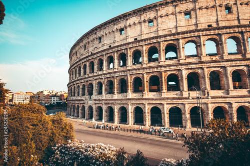 Leinwandbild Motiv The ancient Colosseum in Rome at sunset