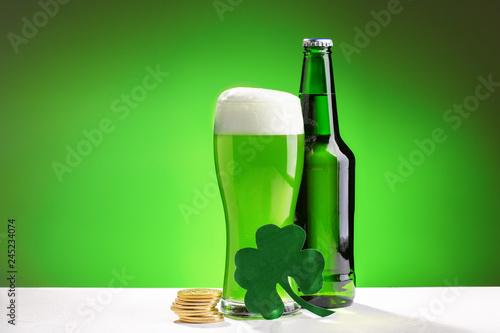 Buttle and glass of fresh green cold beer. Concept for St. Patrick's day. - 245234074