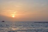 Fototapeta Zachód słońca - sunset over the sea © thewonderalice