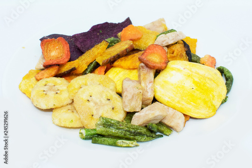 Mixed dried fruits vegetable chips on background - 245291626