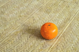 Orange mandarin lying on a soundproof panel made of stone wool.