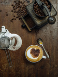 Making coffee on a rustic old wooden table - 245311433