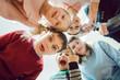 Leinwandbild Motiv Witzige Schüler und Lehrerin als Team in der Schule