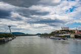 Cityscape of Bratislava with the SNP bridge over Danube river and castle. Bratislava, Slovakia