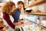 Couple in restaurant choose fresh fruit juice - 245331059
