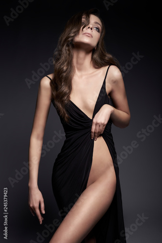 Fashion photo of beautiful lady in black dress.