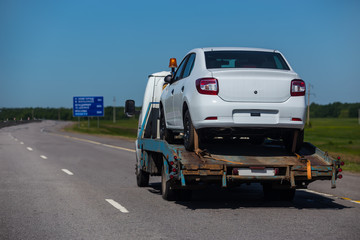 Truck carrying a car .Assistance on roads.