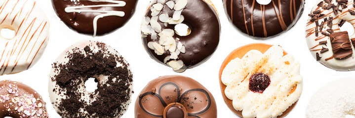 Multiple doughnuts on white background. High resolution image for food industry. © czoborraul