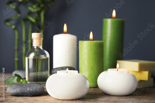 Leinwanddruck Bild Spa composition with candles and cosmetic on table