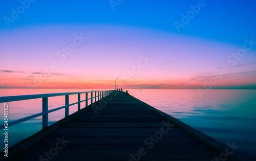 Blue light after sunset over a long pier © Brett
