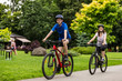 Leinwandbild Motiv Healthy lifestyle - people riding bicycles in city park