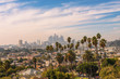 Quadro Los Angeles skyline at sunset with palm trees in the foreground