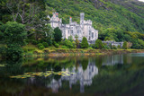 Kylemore Abbey in Ireland with reflections in the Pollacapall Lough