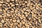 Sorted wood log background texture. Stack of arranged brown wood log background