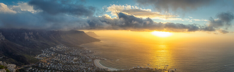 Lion's head top panoramic view of Table Mountain and Cape Town city at sunset with beatiful clouds in the sky