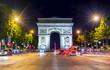 Triumphal arch (Arc de Triomphe) at night, Paris, France