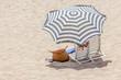 Leinwanddruck Bild - parasol sur plage