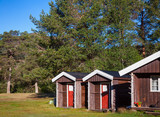 Wooden camping cabins at a campsite in Norway Scandinavia - 245556285