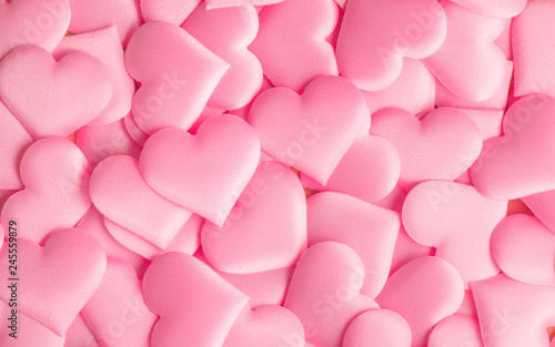 Valentine's Day. Holiday abstract pink Valentine background with satin hearts. Love concept - 245559879