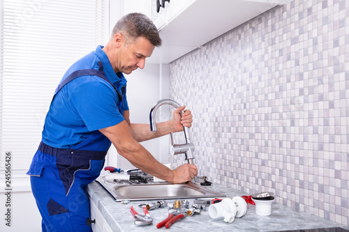 Worker Fixing Water Tap - 245565426