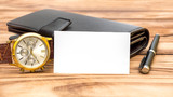 Blank business card with men's accessories on the table. - 245607605