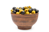 Bowl with green and black olives on white.