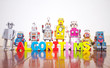 a line of retro robots on a wooden floor with the word ALGORITHMS - 245650626