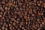 Roasted coffee beans heap, macro closeup
