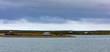 Huts dot Arctic Ocean Coastline NWT Canada