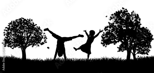 Little kids or children playing in the park or exercising outdoors in silhouette - 245713217