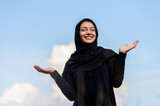 Beautiful middle eastern woman filling joy in the cloudy sky packground. - 245733282