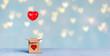 Leinwandbild Motiv rotes Herz in der Geschenkebox