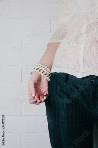 Bracelets and jewelry on a woman's hand - 245772214
