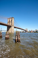 Brooklyn Bridge over East River on a sunny day, New York City, USA.