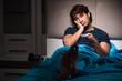 Leinwanddruck Bild - Man watching tv at night in bed