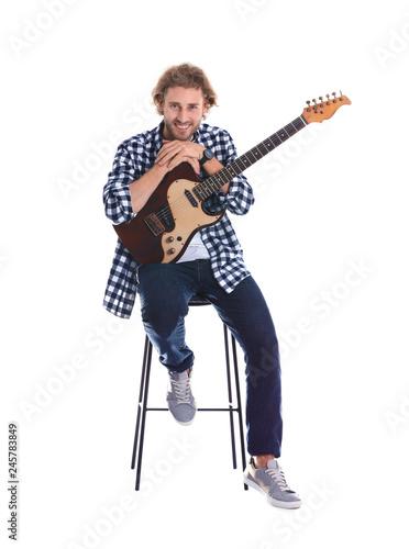 Leinwandbild Motiv Young man with electric guitar on white background